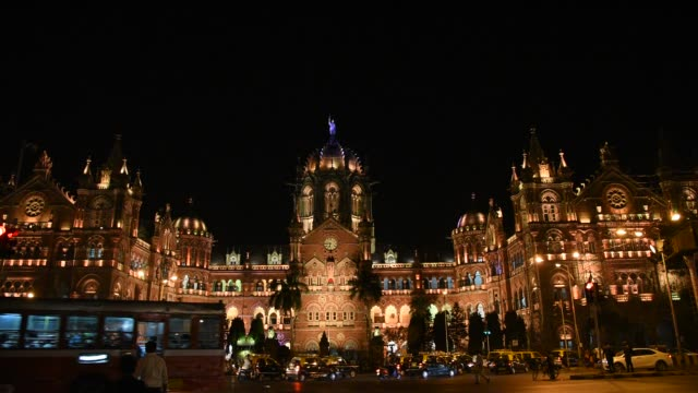 chhatrapati shivaji terminus or victoria terminus at night, mumbai, india. - cityscape stock videos & royalty-free footage