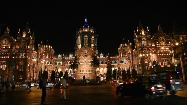 chhatrapati shivaji terminus or victoria terminus at night, mumbai, india. - famous place stock videos & royalty-free footage