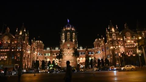 chhatrapati shivaji terminus or victoria terminus at night, mumbai, india. - railway station stock videos & royalty-free footage