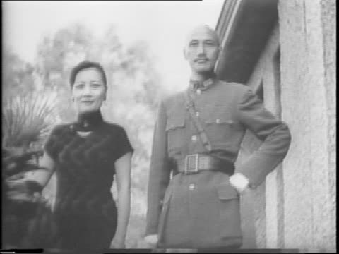 chiang kaishek and wife soong mayling exit car / kaishek and wife pose at top of stairs / close up of chiang kaishek smiling / view of guadalcanal... - chiang kai shek stock-videos und b-roll-filmmaterial