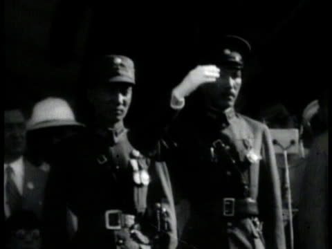 chiang kai-shek at ceremony saluting w/ white gloved hand . train station crowded - taiwan stock videos & royalty-free footage