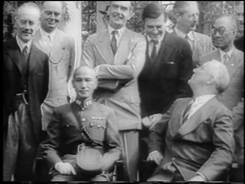 chiang kai-shek + franklin d. roosevelt sitting outdoors / men in background / cairo / newsreel - chiang kai shek stock videos & royalty-free footage