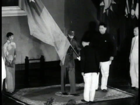 china chiang kaishek presented w/ taiwanese flag at ceremony airplane flying over pagoda airplanes flying in formation rows chiang kaishek wife... - taiwanese flag stock videos & royalty-free footage