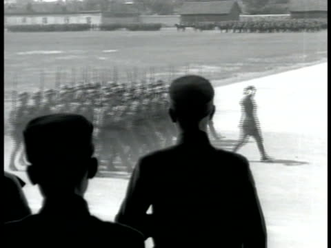 chiang kai-shek reviewing chinese soldiers marching by. horse-drawn artillery on field. vs infantry running across grass & fields dropping in... - chiang kai shek stock videos & royalty-free footage