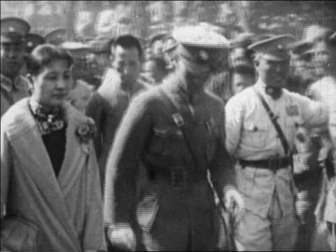 stockvideo's en b-roll-footage met chiang kaishek wife walking past camera / china / newsreel - chiang kai shek
