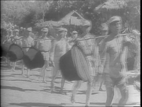 chiang kaishek's troops marching with horses on a dirt road lined with civilian onlookers / color guard and chinese infantry marching past civilians... - chiang kai shek stock-videos und b-roll-filmmaterial