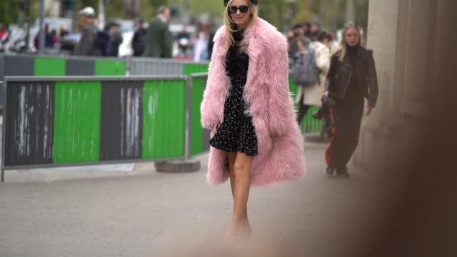 chiara ferragni wears a beret hat, sunglasses, a pink fur coat, a black dress chanel slinback shoes, outside giambattista valli, during paris fashion... - black dress stock videos & royalty-free footage