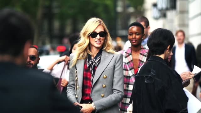 chiara ferragni wears sunglasses, a gray blazer jacket, a red tartan checked shirt, black leather pants, earrings, during london fashion week... - gray jacket stock videos & royalty-free footage