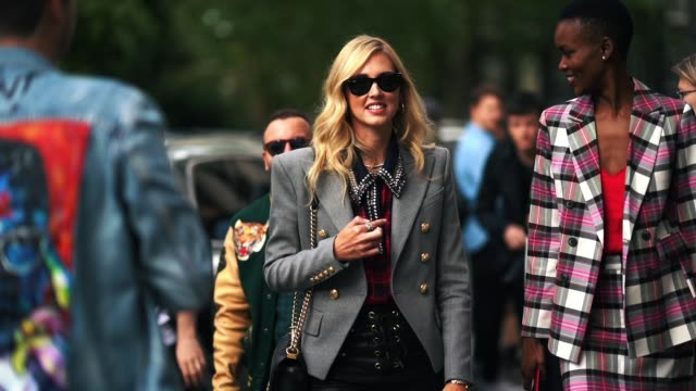stockvideo's en b-roll-footage met chiara ferragni wears sunglasses a gray blazer jacket a red tartan checked shirt black leather pants earrings during london fashion week september... - oorbel