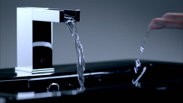 chic design faucet - automatic stock videos & royalty-free footage