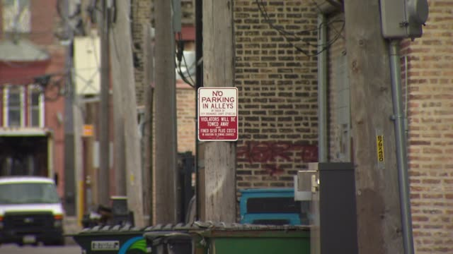 """chicago alley with a """"no parking"""" sign on april 24, 2015. - no parking sign stock videos & royalty-free footage"""