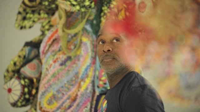 Chicago artist Nick Cave and the Associate Curator of Contemporary Art at Denver Art Museum provide a peek at the upcoming exhibit Soujourn as crews...