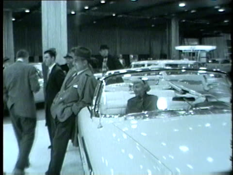 chicago auto show display preview including cars and models in 1959 the show ran from january 1625 - 1959 stock-videos und b-roll-filmmaterial