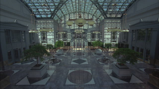A Chicago building's atrium features small potted trees and a large interior courtyard.