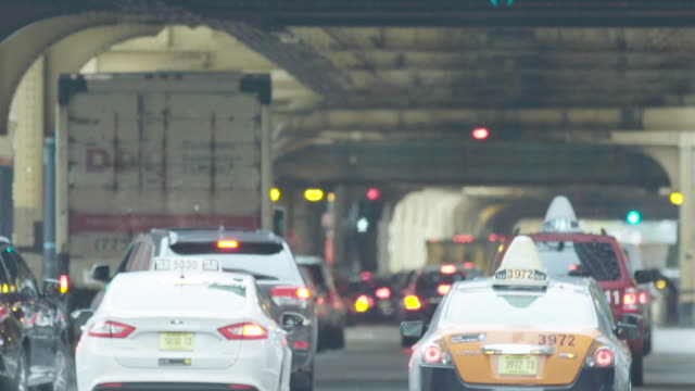 Chicago cars, traffic in city under elevated train