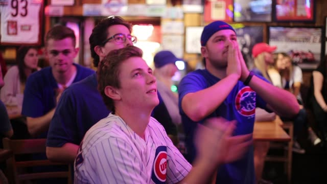 Chicago Cubs fan Andrew Barrett prays at Nick's English Hut while watching a close game against the Cleveland Indians in the final innings The Cubs...
