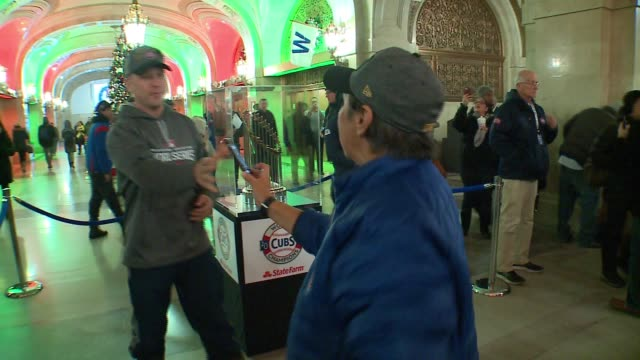 WGN Chicago Cubs Fan with the Commissioner's Trophy After World Series Win on Dec 15 2016 at Chicago's City Hall