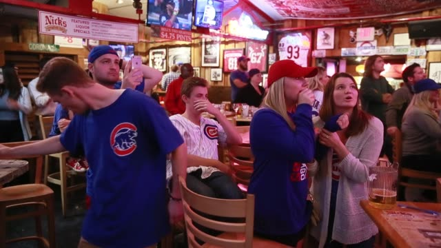 chicago cubs fans at nick's english hut in bloomington, indiana celebrate the first world series win in 108 years after watching the final out... - baseball world series stock videos & royalty-free footage