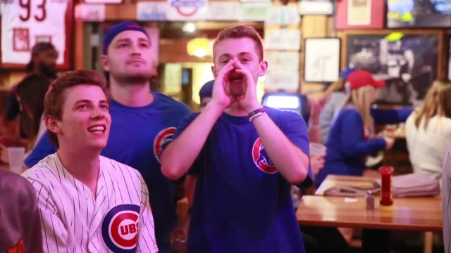 vídeos de stock, filmes e b-roll de chicago cubs fans at nick's english hut in bloomington indiana watch and react as their team plays the cleveland indians eventually winning the first... - bloomington indiana