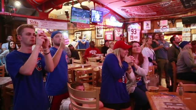 chicago cubs fans at nick's english hut in bloomington, indiana watch and react as their team plays the cleveland indians eventually winning the... - inning stock videos & royalty-free footage
