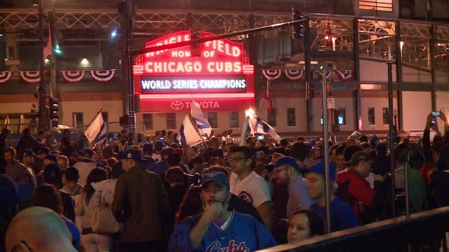 chicago cubs fans celebrate outside wrigley field after world series win on nov. 2, 2016. - baseball world series stock videos & royalty-free footage