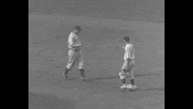 Chicago Cubs pitcher Guy Bush on mound during Game 4 of the World Series / New York Yankees player Lou Gehrig hits a double / SOT vendor in stands...