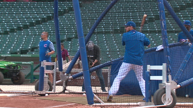 chicago cubs players at batting practice at wrigley field on oct. 3, 2017. - batting stock videos & royalty-free footage