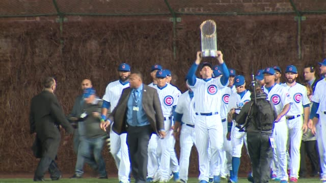chicago cubs walk onto field with 2016 world series trophy at 2017 home opener on april 10, 2017. - baseball world series stock videos & royalty-free footage
