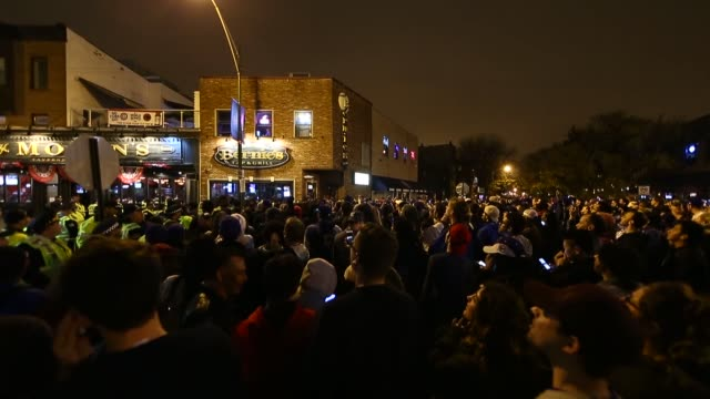 chicago fans celebrate the chicago cubs 8-7 victory over the cleveland indians in cleveland in 10th inning in game seven of the 2016 world series,... - baseball world series stock videos & royalty-free footage