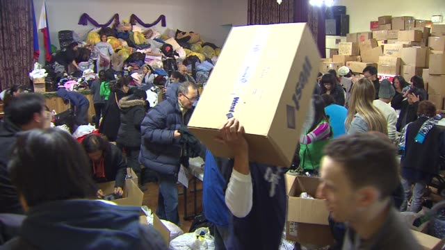 chicago filipino community gathers aid for typhoon victims people organizing donations for typhoon victims on november 13 2013 in chicago illinois - donation box stock videos & royalty-free footage