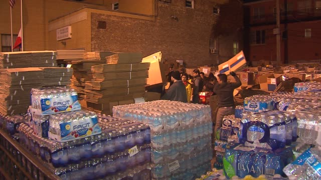 chicago filipino community gathers aid for typhoon victims people organizing donations for typhoon victims on november 13 2013 in chicago illinois - 慈善事業点の映像素材/bロール