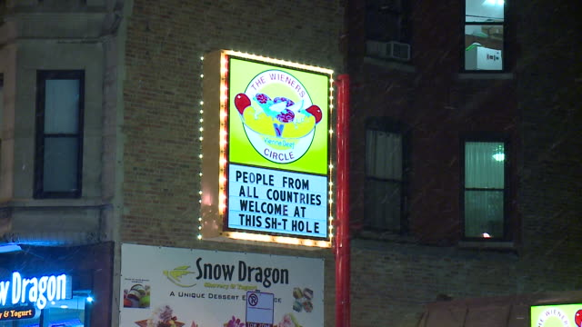 chicago hot dog stand, the wiener's circle, the infamous lincoln park late-night spot favored by those spilling out of the bars after last call, used... - capital letter点の映像素材/bロール