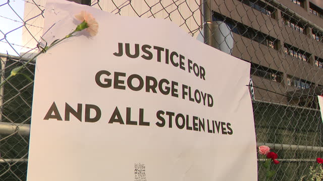 chicago, il, u. s. - protestors with placards during a march in memory of george floyd on the first day of the derek chauvin trial in minneapolis,... - poster stock videos & royalty-free footage