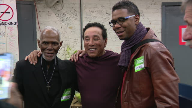 chicago, il, u.s. - a reception was given for legendary singer and songwriter, smokey robinson backstage before performing at the chicago theatre, on... - photographing stock videos & royalty-free footage