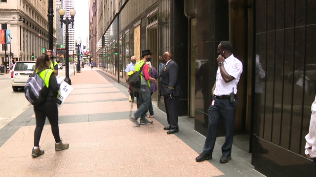 wgn chicago il us activists in front of bank of america building demand safe school reopenings on monday august 3 2020 demand safe schools coalition... - bank of america stock videos & royalty-free footage