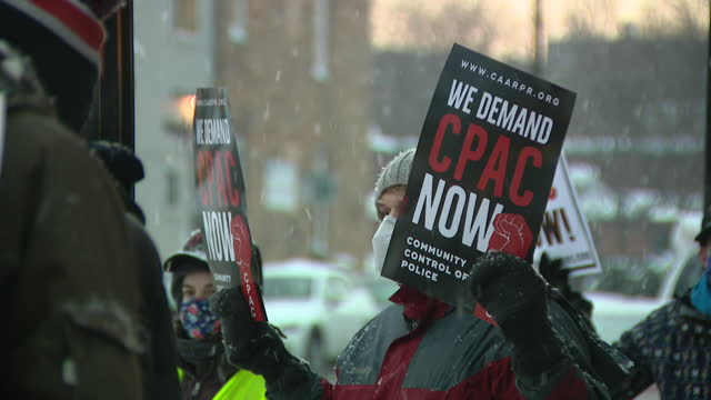 chicago, il, u.s. - activists rally on cold, snowy day, calling on the city to enact sweeping police reform, in chicago's rogers park, on thursday,... - enacting stock videos & royalty-free footage