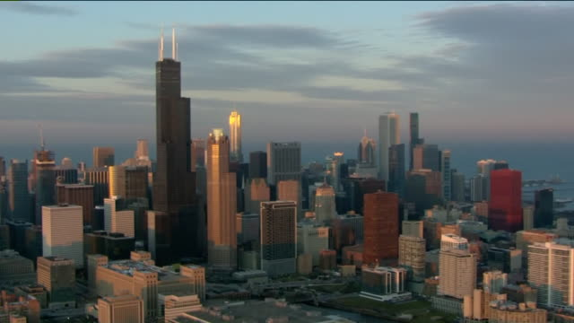 wgn chicago il us aerial view of downtown chicago at sunset on tuesday december 3 2019 - cityscape stock videos & royalty-free footage