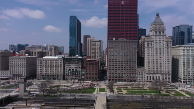 chicago, il, u.s. - aerial view of grant park area against chicago skyline on tuesday, april 28, 2020. - downtown stock videos & royalty-free footage