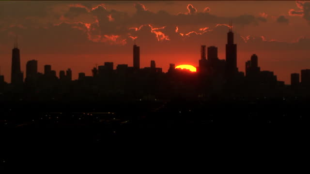 wgn chicago il us aerial view of the sun rising above city on tuesday july 30 2019 - cloudscape stock videos & royalty-free footage