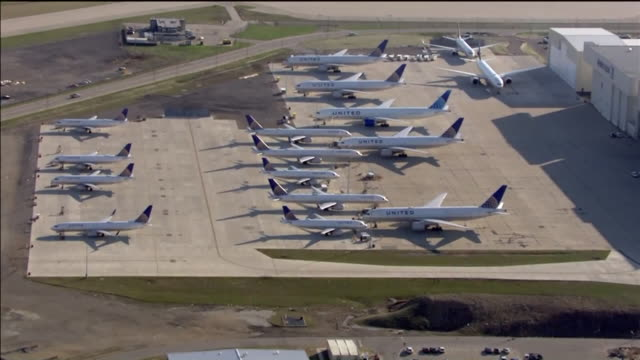 chicago, il, u.s. - aerial views of rows of united and american airlines planes at o'hare airport tarmac during covid-19 pandemic on wednesday, april... - stationary stock videos & royalty-free footage