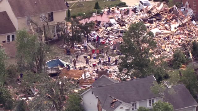 chicago, il, u.s. - aftermath of ef-3 tornado hitting naperville, aerial view, on monday, june 21, 2021. - helicopter point of view stock videos & royalty-free footage