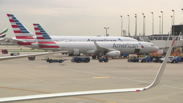 chicago, il, u.s. - american airlines airplanes on tarmac at o'hare airport on tuesday, june 30, 2020. the same day the government's top experts in... - stationary stock videos & royalty-free footage