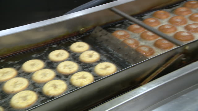 chicago, il, u.s. - apple cider donuts production at a bakery located inside the farm market at all seasons orchard on saturday, october 3, 2020. all... - other stock videos & royalty-free footage