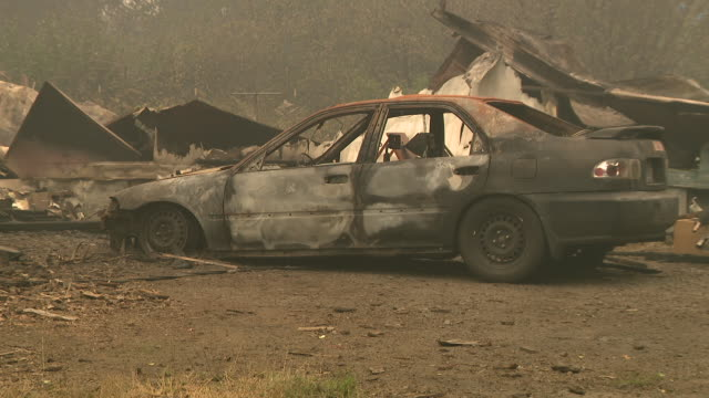 chicago, il, u.s. - car and building burnt in wildfire in linn county, oregon on tuesday, september 15, 2020. fires continue to burn tuesday night,... - burnt stock videos & royalty-free footage
