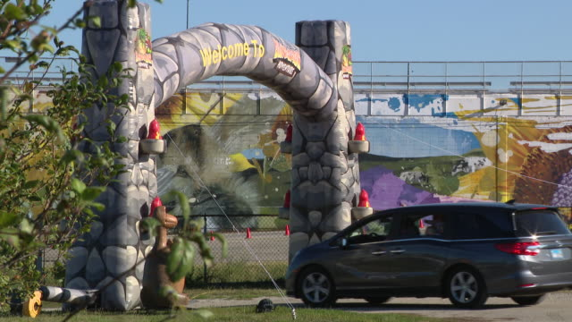 wgn chicago il us cars entering a drivethru animatronic dinosaur display amid coronavirus pandemic on saturday september 5 2020 at the dupage county... - dupage county stock videos & royalty-free footage