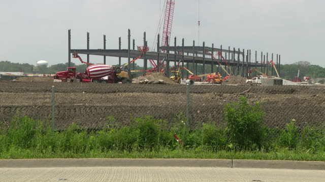 chicago, il, u.s. - cement mixers on construction site. two new amazon fulfillment centers are coming to chicago's southern suburbs, bringing... - new hire stock videos & royalty-free footage