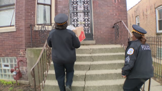 wgn chicago il us chicago police officers deliver food to seniors during covid19 outbreak on thursday mar 26 2020 - chicago illinois stock videos & royalty-free footage