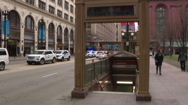 wgn chicago il us chicago's jackson station of red line subway l stop entrance plus police activity downtown on tuesday feb 4 2020 - chicago 'l' stock videos & royalty-free footage