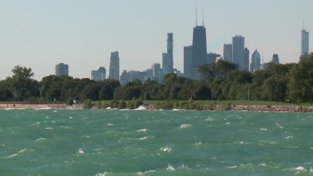 wgn chicago il us chopping waters on lake michigan with chicago skyline in background on saturday august 24 2019 - skyscraper stock videos & royalty-free footage