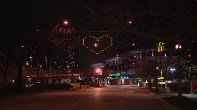 wgn chicago il us city street with heart shape illumination on marriott hotel at night during covid19 outbreak on thursday april 2 2020 - heart shape stock videos & royalty-free footage